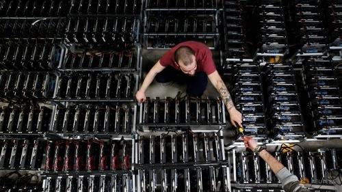 file photo  employees work on bitcoin mining computers at bitminer factory in florence 1